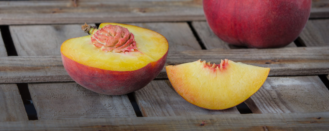 Peaches, appreciated for their juicy and perfumed flesh